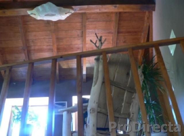 4th Level Landing – Custom Designed and Built Rocking Chair of Chestnut