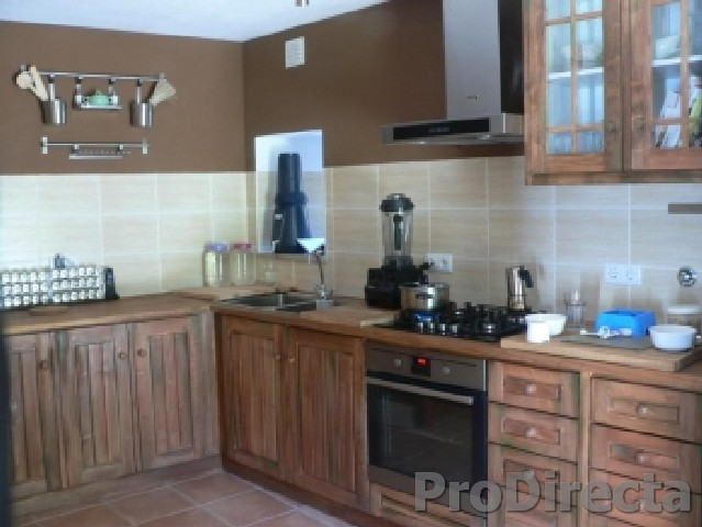 Kitchen – Custom Designed and Built Northern Pine Cabinets and Thick Natural